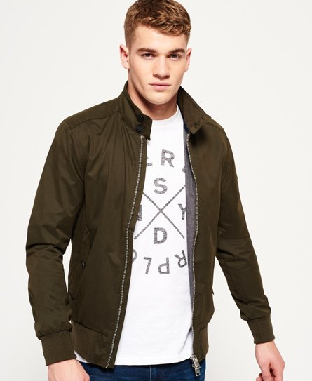 Superdry men\\\'s Nordic Harrington jacket. This tailored Harrington is fully lined inside with a single inner pocket. Outside, the jacket has a front zip fastening and two front pockets with button fastening. The Nordic Harrington is finished with ribbed collar, cuff and hem and a Superdry leather patch on the sleeve. Model wears: Medium Model height: 6\\\' 1\\\