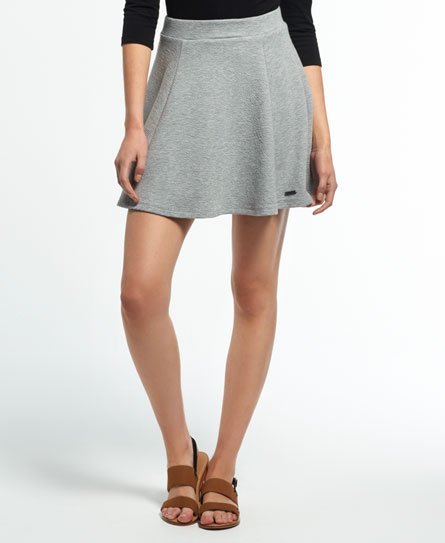 Superdry women\\\'s Christa jacquard skater skirt. A classic skater skirt in soft textured jersey fabric with a back zip fastening. The skirt is finished with a metal Superdry logo badge above the hem. Model wears: Small Model height: 5\\\'9\\\
