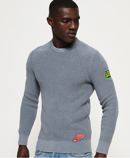 Superdry men\\\'s Garment Dye Wash texture crew neck jumper. This classic crew neck, waffle knit jumper is the perfect transitional wardrobe piece and features applique Superdry logo badges on both sleeves. The Garment Dye Wash texture crew neck jumper is finished with an applique logo badge above the hem.