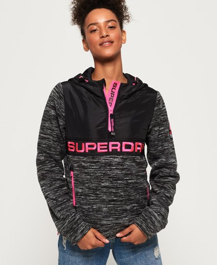 Superdry women\\\'s Storm hybrid overhead hoodie. This hoodie is the perfect layering piece, featuring fleece sleeves and body with zip side panels and a bungee cord hood. The Storm hybrid overhead hoodie also features a Superdry logo on the placket, two zip pockets to hold your belongings and a Superdry logo embroidered on the shoulder. This hoodie has been inspired by mountaineering, making it the perfect transitional jacket for the colder seasons.