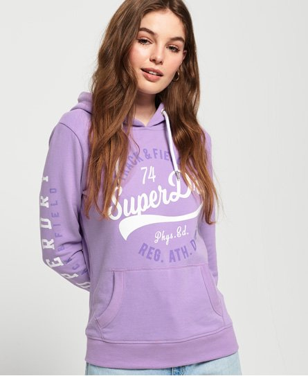 Superdry women\\\'s Track & Field lightweight hoodie. A lightweight, overhead hoodie featuring a drawstring hood and Track & Field logo graphic on the chest and down one sleeve. Finished with a logo tab on one cuff, pair with jeans and trainers for an easy, everyday outfit. Slim fit
