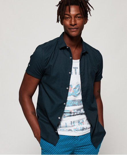 Superdry men\\\'s Royal Oxford slim short sleeve shirt. This slim fitting, button down cotton shirt features stitched up sleeves and an embroidered Superdry logo on the chest. The shirt is finished with a Superdry Shirt Co logo patch on the sleeve.