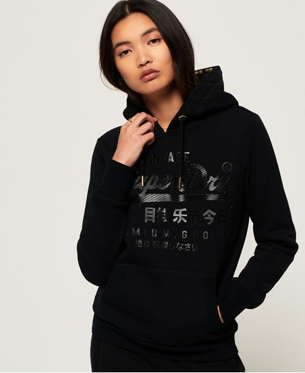 Superdry women\\\'s Vintage Logo Premium icon hoodie. This vintage logo hoodie is a perfect addition to your wardrobe staples. Featuring a drawstring hood, ribbed cuffs, ribbed hem and a front pouch pocket. Completing this hoodie is a rubber Superdry logo on the front and a discrete Superdry logo tab on the side. Slim fit