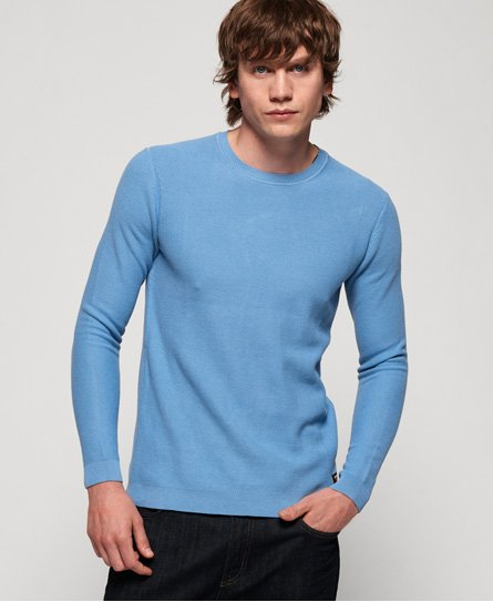 Superdry men\\\'s SUPIMA® cotton crew jumper. This lightweight crew neck jumper features long sleeves and a ribbed collar, cuffs and hem. Completed with a Superdry logo badge above the hem. Will look great paired with jeans and boots this season. SUPIMA® is a superior type of cotton grown in the USA. SUPIMA® Cotton is unique due to its extra-long staple fibres which gives the cotton its premium properties, producing softer and longer lasting fabrics.