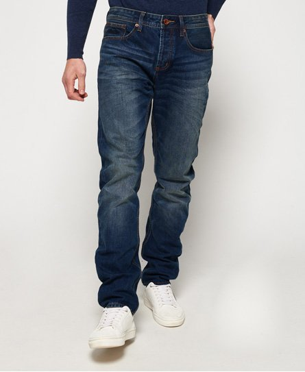 Superdry men\\\'s Copperfill loose jeans. A pair of relaxed fit denim jeans in the classic five pocket design with a button fly. The jeans also feature Superdry branded rivets and embroidered Vintage Superdry logo on the coin pocket. The Copperfill loose jeans are finished with an embossed Superdry logo patch on the back waistline and a Superdry logo tab on one of the back pockets.