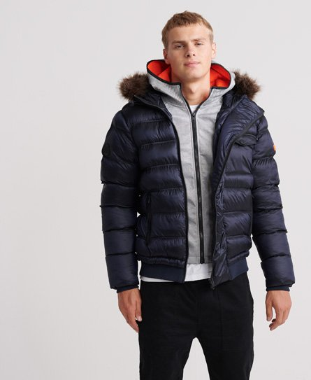 Superdry men\\\'s Icon Rescue Puffer jacket. We\\\'ve shaken up the classic puffer jacket by giving it a double zip fastening creating the two jacket look. Two front pockets and a single breast pocket with popper fastening, ribbed hem and cuff, and a drawstring hood. Finished with a rubber Superdry logo badge on one sleeve.