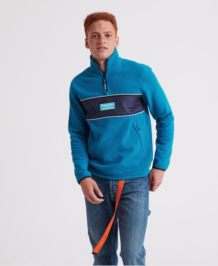 Superdry men\\\'s Polar International track top. Perfect for layering. This fleece style track top features a zip fastening, zip pockets and elasticated cuffs. Finished off with a Superdry logo badge across the front.