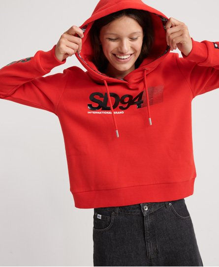 Superdry women\\\'s Nineties Crop hoodie. This hoodie features a textured Superdry logo design on the chest and one sleeve and Superdry branded design on the inner rim of the hood. Also featured is a drawstring hood and ribbed cuffs and hem. Complete with a Superdry logo badge on one sleeve. Wear this piece with jeans and trainers to finish the look. Relaxed fit