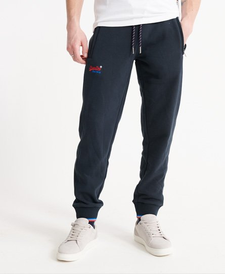 Superdry men\\\'s Orange Label Elevated zip pocket joggers. These joggers feature, an elasticated drawstring waist, two front zipped pockets, ribbed elasticated cuffs and a single back pocket. Finished with an embroidered Superdry logo on the front and striped detailling to the waist and cuffs. Slim fit