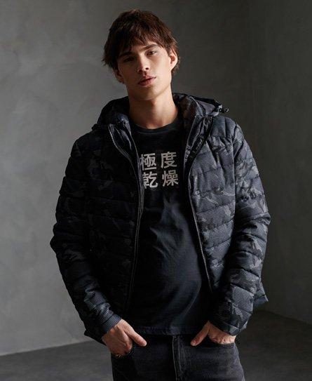 Superdry men\\\'s tweed double zip Fuji Jacket. Keep warm this season with this Fuji jacket, featuring a main double zip fastening, two zip fastened pockets, elasticated cuffs and a removable hood with a bungee cord adjuster and zip fastening. Completed with an all over tweed inspired design and Superdry branding on the zip pulls.